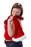 Overweight woman with Santa hat smiling royalty free stock images