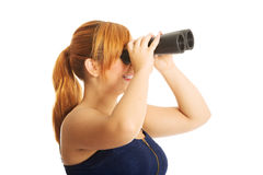 Overweight woman seeking with binocular Stock Photo