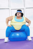 Overweight Woman Sitting On Exercise Ball royalty free stock photography