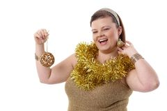 Overweight woman smiling at Christmas Stock Photo