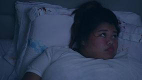Overweight woman suffering from insomnia. Restless overweight woman suffering from insomnia, lying on the bed at night. Shot in 4k resolution stock video