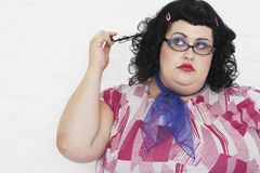 Overweight Woman Twisting Strand Of Hair Stock Photography