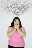 Overweight woman under crumpled symbol Royalty Free Stock Image