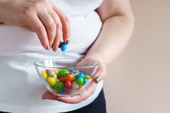 Overweight woman with unhealthy fattening food. Fattening food, high-calorie snack. weight loss, dietary, balanced nutrition. overweight woman eating unhealthy stock photo