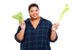 Overweight woman vegetables Royalty Free Stock Images