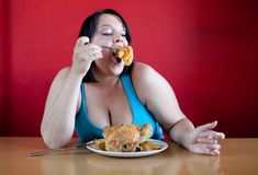 Overweight woman with a whole chicken Stock Photo