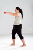 Overweight woman working out Stock Photography