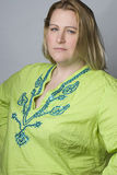 Overweight woman in wrinkle shirt Stock Image