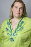 Overweight woman in wrinkle shirt Royalty Free Stock Image