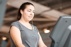 Overweight, work at the gym. Hard work at the gym with overweight royalty free stock photo