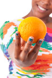 Overweight young black woman holding an orange - African people Stock Photos