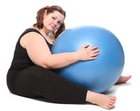 Overweight young woman with blue ball. Stock Photo