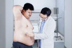 Overweigth man checkup in hospital Royalty Free Stock Photography