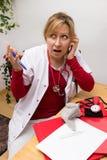 Overweldigde verpleegster Stock Foto