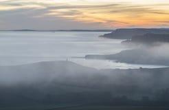 Overweldigende zonsondergang over de Kustlijn van Dorset Stock Afbeelding