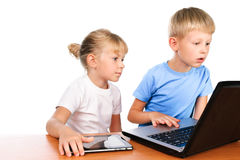 Overwhelmed boy and girl using laptop Royalty Free Stock Photos