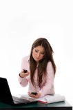 Overwhelmed business woman talking on multiple phones Royalty Free Stock Photo