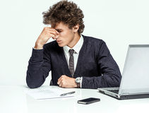 Overwhelmed Businessman dissatisfied with his earnings Royalty Free Stock Images