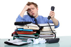 An overwhelmed businessman. Royalty Free Stock Photo