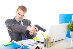 Overwhelmed businessman in upset face expression holding gun pointing computer stock photography