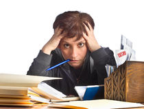 Overwhelmed with finances. Stressed woman working on taxes and household finances Royalty Free Stock Images