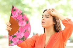 Overwhelmed girl suffering heat stroke in the street royalty free stock photos