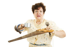 Overwhelmed by Home Improvements. Older lady holding tools.  She is confused and overwhelmed by home improvement project.  Isolated on white Stock Photos