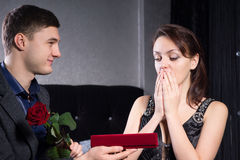 Overwhelmed Lady Receives Presents from her Man Royalty Free Stock Photography