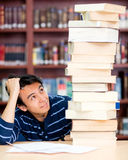 Overwhelmed male student Royalty Free Stock Photo