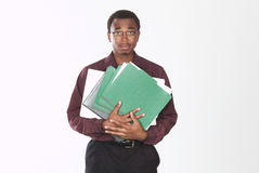 Overwhelmed man. A man standing, holding folders and looking overwhelmed Royalty Free Stock Photo