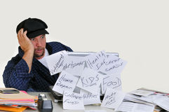 Overwhelmed man with finances Stock Photography