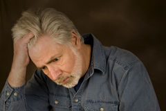 Overwhelmed. Mature man feeling overwhelmed by life Royalty Free Stock Images
