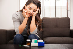 Overwhelmed with medicines Royalty Free Stock Image