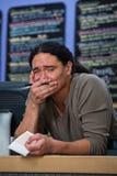 Overwhelmed Restaraunt Worker. Overwhelmed Hispanic male restaurant owner at counter Royalty Free Stock Images