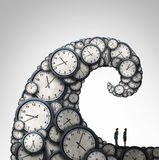 Overwhelmed Schedule. And overtime working hours concept as people looking at a giant wave made of time clock objects with 3D illustration elements Royalty Free Stock Photography