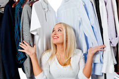 Overwhelmed woman with clothes Stock Photography