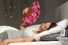 Overwhelmed woman fanning suffering heat stroke stock photo