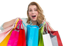 Overwhelmed young woman with shopping bags Royalty Free Stock Photos