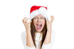 Overwhelmed young woman wearing red santa claus hat, screaming going crazy Royalty Free Stock Image