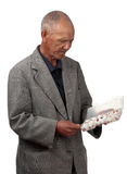 Overwhelming tablets. A stressed old man assesses a container filled with a multitude of different tablets Stock Images