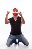 Overwinning, gelukkige en doelschreeuwemoties van Oostenrijkse voetbalventilator in spelsteun van Oostenrijk Stock Foto
