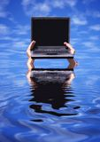 Overwork. Laptop with empty screen on the hands and reflections(special f/x royalty free stock image