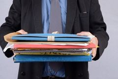 Businessman with folders in hand stock photos
