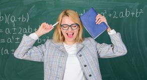 Overwork and lack of support driving teacher out of profession. School toxic routine. Teacher stress and burnout. Teacher woman with book chalkboard background stock image