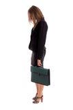 Overworked женщина дела заботя ее портфель Стоковые Фото