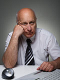 Overworked. Elderly man tired to work Stock Images