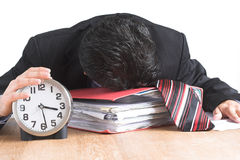 Overworked. Image of an exhausted businessman trying to get the job done before the deadline Stock Image