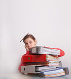 Overworked. A young and beautiful female worker is stressed with a lot of paperwork in front of her and a pencil in her hair. A lot of copyspace Stock Photography