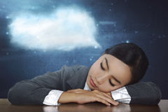 Overworked asian business woman sleeping in desk at work Stock Images