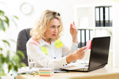 Overworked business lady working in office and Stock Photo